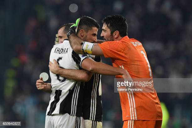 Giorgio Chiellini Sami Khedira and Gianluigi Buffon of Juventus FC celebrate victory at the end of the Serie A match between Juventus FC and FC...