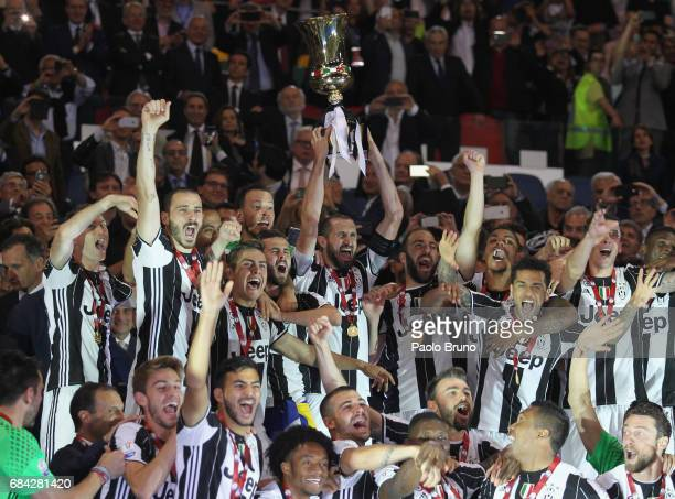 Giorgio Chiellini with his teammates of Juventus FC celebrates with the trophy after winning the TIM Cup Final match against SS Lazio and Juventus FC...