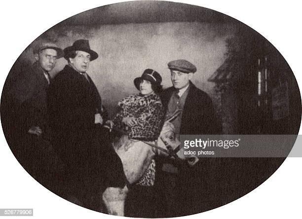Giorgio De Chirico, Max Ernst, Gala Eluard and Benjamin P��ret at the Montmartre funfair in Paris . In 1924.