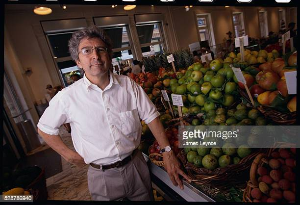 Giorgio DeLuca founder of Dean DeLuca grocery stores stands in the produce section of his SoHo store