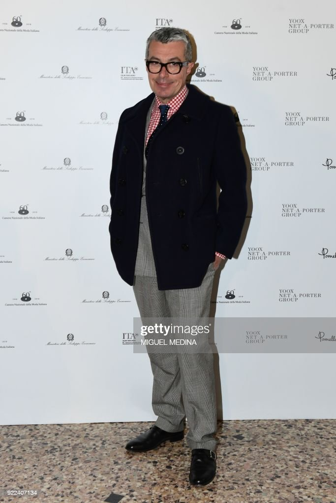 Giorgio Guidotti poses upon the arrival to the exhibition preview of 'Italiana, Italy Through the Lens of Fashion' at Palazzo Reale in Milan, on February 21, 2018. / AFP PHOTO / Miguel MEDINA