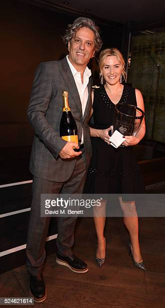 Giorgio Locatelli and Kate Winslet attend the GQ Food Drink Awards at 100 Wardour St on April 26 2016 in London England