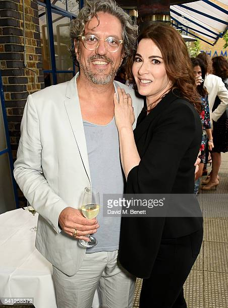 Giorgio Locatelli and Nigella Lawson attend the NSPCC Dinner at River Cafe on June 19 2016 in London England