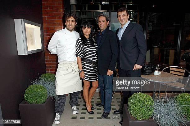 Giorgio Locatelli with his wife Plaxy Locatelli Federico Sali and Massimiliano Sali pose at the opening of Giorgi Locatelli's new restaurant...