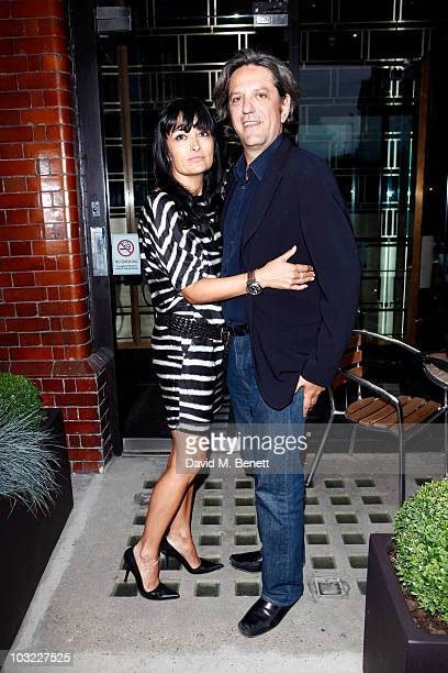 Giorgio Locatelli with his wife Plaxy Locatelli pose at he the opening of his new restaurant 'Tinello' on August 03 2010 in London England