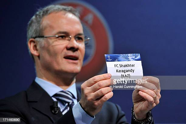 Giorgio Marchetti UEFA Competition Director shows the name FC Shakhter Karagandy during the UEFA Champions League Q2 qualifying round draw at the...