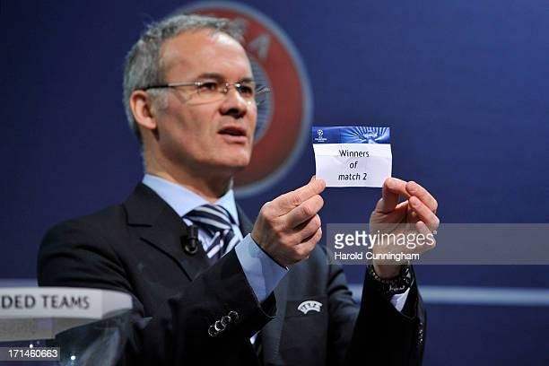 Giorgio Marchetti UEFA Competition Director shows the name Winners of match 2 during the UEFA Champions League Q2 qualifying round draw at the UEFA...