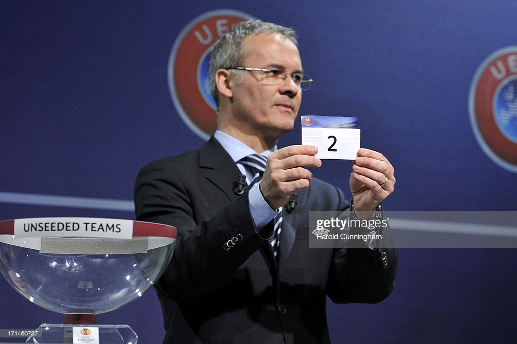 Giorgio Marchetti, UEFA Competition Director, shows the number 2 during the UEFA Europa League Q1 qualifying round draw at the UEFA headquarters on June 24, 2013 in Nyon, Switzerland.