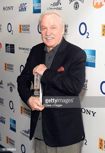 Giorgio Moroder with his Classical Award at the Nordoff Robbins 02 Silver Clef awards at London Hilton on July 4 2014 in London England