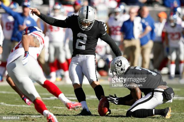 Giorgio Tavecchio of the Oakland Raiders kicks an extra point against the New York Giants during their NFL game at OaklandAlameda County Coliseum on...