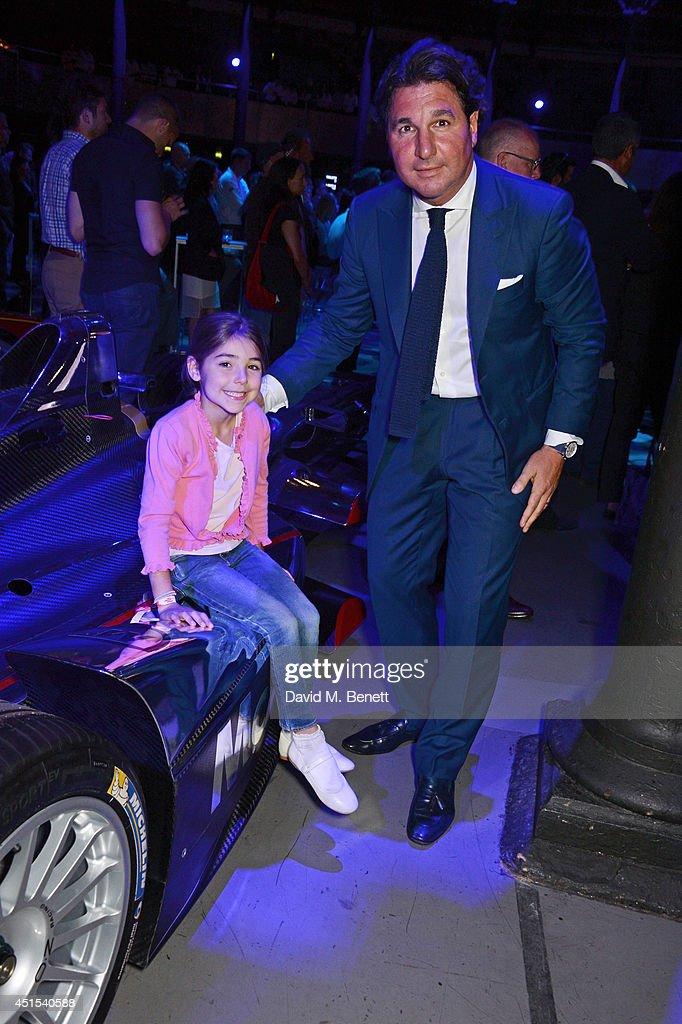 Giorgio Veroni (R) and daugher Violet attend the global launch of the FIA Formula E Championship, celebrating the founding of the first ever all-electric race series, at The Roundhouse on June 30, 2014 in London, England.