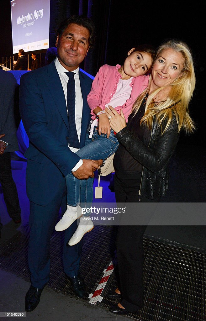 Giorgio Veroni (L) and Tamara Beckwith pose with daughter Violet at the global launch of the FIA Formula E Championship, celebrating the founding of the first ever all-electric race series, at The Roundhouse on June 30, 2014 in London, England.