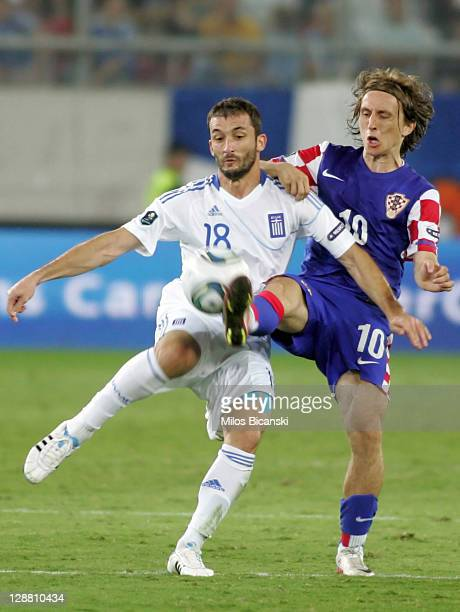 Giorgios Fotakis of Greece is tackled by Luka Modric of Croatia during the UEFA Euro 2012 Qualifying round group F match between Greece and Croatia...