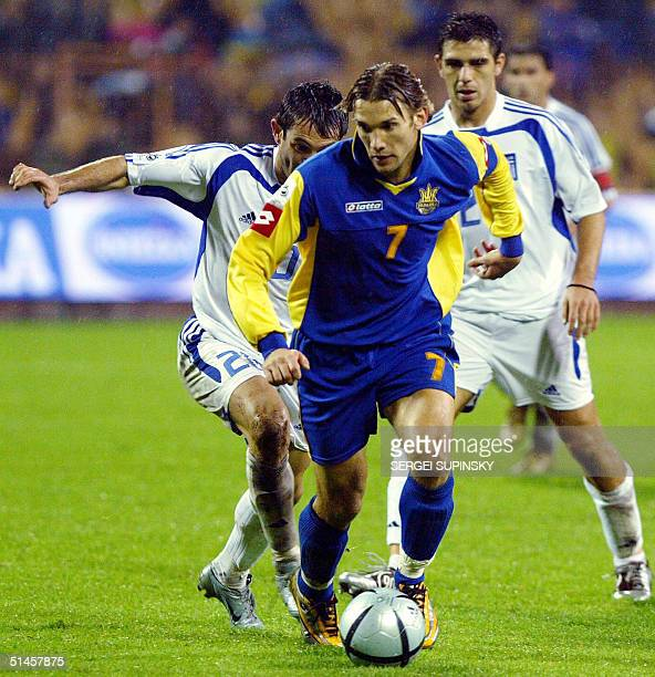 Giorgios Karagounis and Kostas Katsouranis players of the National team of Greece vie for the ball against Andriy Shevchenko player of the National...