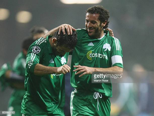 Giorgios Karagounis celebrates with team mate Giannis Goumas of Panathinaikos after the UEFA Champions League Group B match between Werder Bremen and...