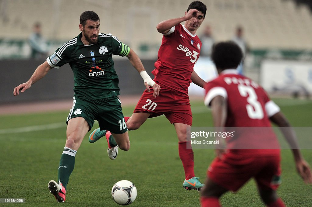 Giorgios Seitaridis (L) of Panathinaikos FC competes for the ball with Mantalos Petros (C) of Skoda Xanthi during the Superleague match between Panathinaikos FC and Skoda Xanthi at OAKA Stadion on February 10, 2013 in Athens,Greece.