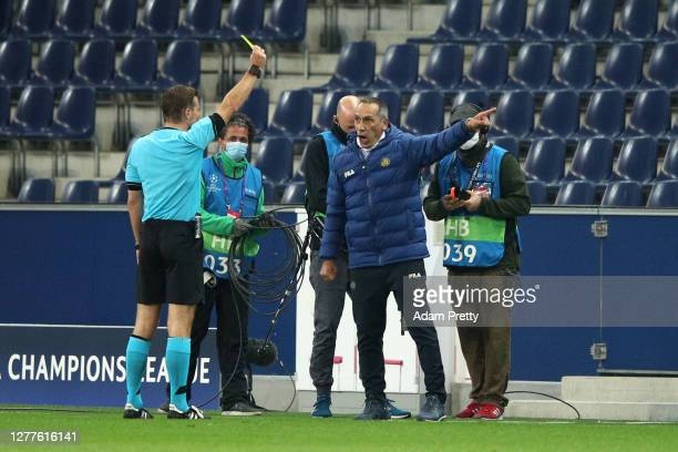 Giorgos Donis, Manager of Maccabi Tel-Aviv is shown two yellow cards and sent off by referee Felix Brych during the UEFA Champions League Play-Off...
