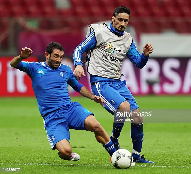 Giorgos Karagounis is challenged by Nikos Liberopoulos during a Greece training session ahead of the UEFA EURO 2012 Group A match against Poland at...