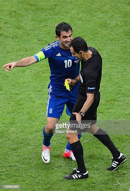 Giorgos Karagounis of Greece appeal to Referee Carlos Velasco Carballo for handball during the UEFA EURO 2012 group A match between Poland and Greece...