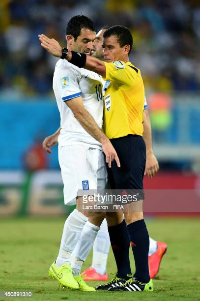 Giorgos Karagounis of Greece appeals to referee Joel Aguilar during the 2014 FIFA World Cup Brazil Group C match between Japan and Greece at Estadio...