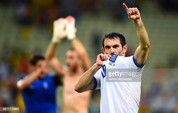 Giorgos Karagounis of Greece celebrates after defeating the Ivory Coast 21 during the 2014 FIFA World Cup Brazil Group C match between Greece and the...