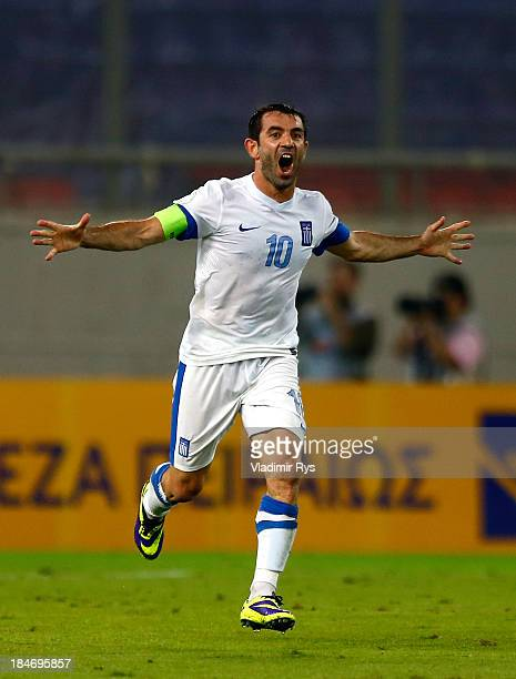 Giorgos Karagounis of Greece celebrates after scoring his team's second goal during the group G FIFA 2014 World Cup Qualifier match between Greece...