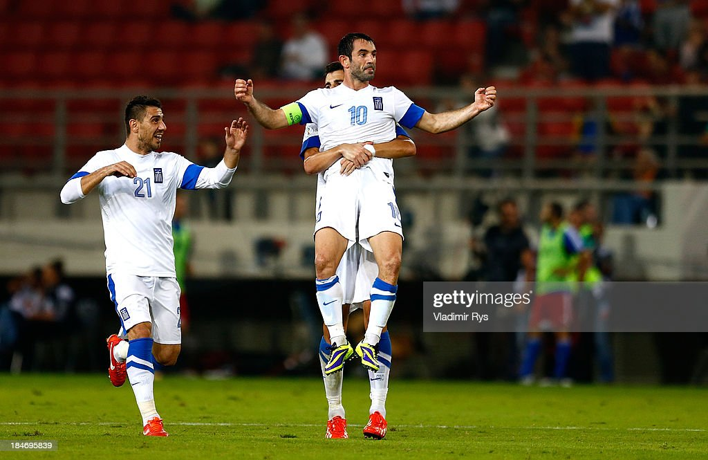 Giorgos Karagounis of Greece celebrates scoring with team mates Kostas Katsouranis (L) and Dimitris Siovas after scoring his team's second goal during the group G FIFA 2014 World Cup Qualifier match between Greece and Liechtenstein at Karaiskakis Stadium on October 15, 2013 in Athens, Greece.