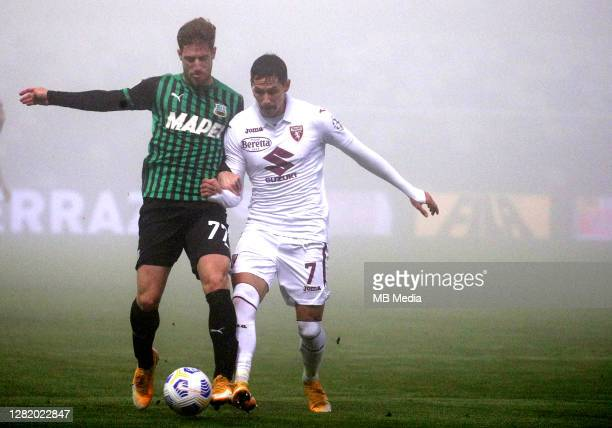 Giorgos Kriakopoulos of US Sassuolo competes for the ball with Sasa Lukic of Torino FC during the Serie A match between US Sassuolo and Torino FC at...