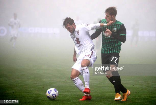 Giorgos Kriakopoulos of US Sassuolo competes for the ball with Simone Verdi of Torino FC during the Serie A match between US Sassuolo and Torino FC...