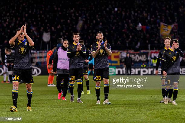Giorgos Merkis of Apoel thanks supporters for standing during the UEFA Europa League round of 32 second leg match between FC Basel and APOEL Nikosia...