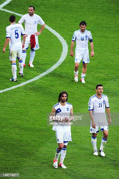 Giorgos Samaras and Kostas Katsouranis of Greece leave the field during the UEFA EURO 2012 group A match between Greece and Czech Republic at The...