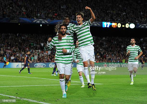 Giorgos Samaras of Celtic FC celebrates scoring with his teammates Mikael Lustig and Efe Ambrose during the UEFA Champions League group G match...