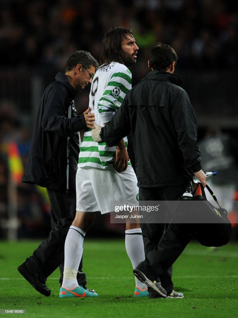 Giorgos Samaras (C) of Celtic FC is being helped off the pitch after injuring himself during the UEFA Champions League group G match between FC Barcelona and Celtic FC at the Camp Nou stadium on October 23, 2012 in Barcelona, Spain.