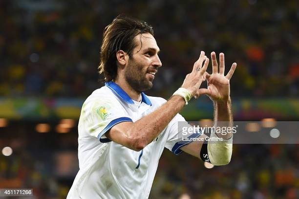 Giorgos Samaras of Greece celebrates scoring his team's second goal on a penalty kick during the 2014 FIFA World Cup Brazil Group C match between...