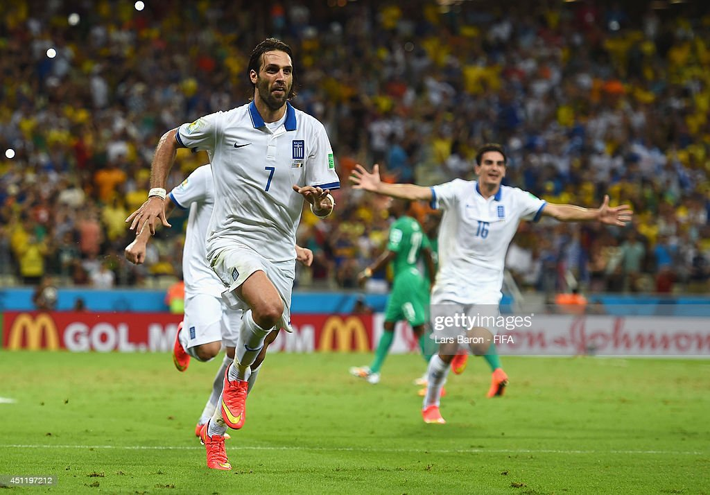Giorgos Samaras of Greece celebrates scoring his team's second goal from the penalty spot during the 2014 FIFA World Cup Brazil Group C match between Greece and Cote D'Ivoire at Estadio Castelao on June 24, 2014 in Fortaleza, Brazil.