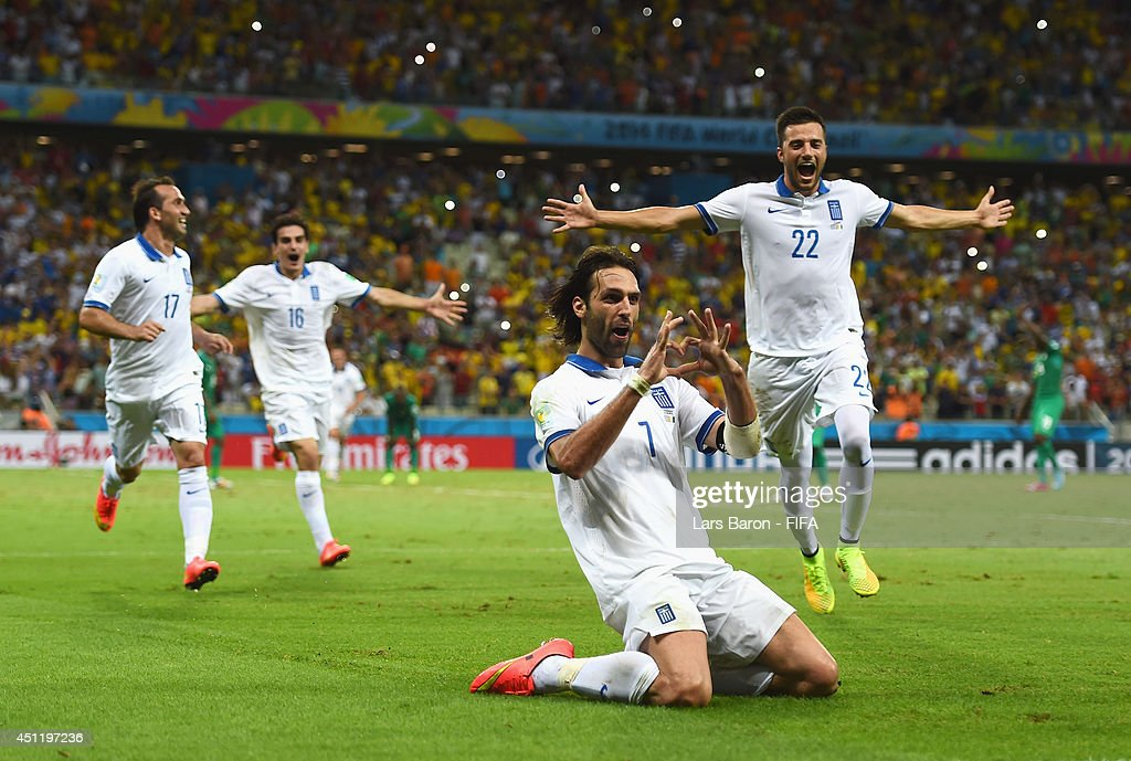Giorgos Samaras of Greece celebrates scoring his team's second goal from the penalty spot with team mates during the 2014 FIFA World Cup Brazil Group C match between Greece and Cote D'Ivoire at Estadio Castelao on June 24, 2014 in Fortaleza, Brazil.