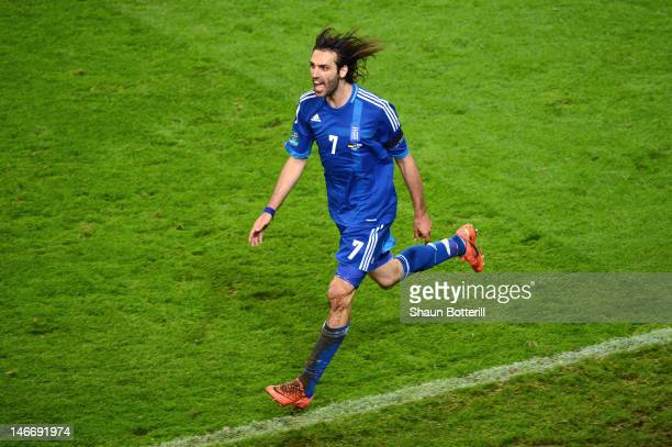 Giorgos Samaras of Greece celebrates scoring their first goal during the UEFA EURO 2012 quarter final match between Germany and Greece at The...