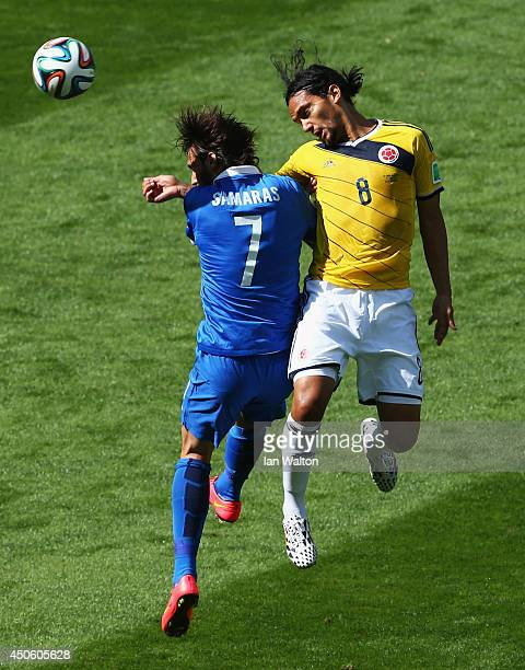 Giorgos Samaras of Greece goes up for a header against Abel Aguilar of Colombia during the 2014 FIFA World Cup Brazil Group C match between Colombia...