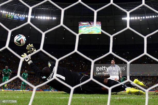 Giorgos Samaras of Greece scores his team's second goal from the penalty spot past Boubacar Barry of the Ivory Coast during the 2014 FIFA World Cup...