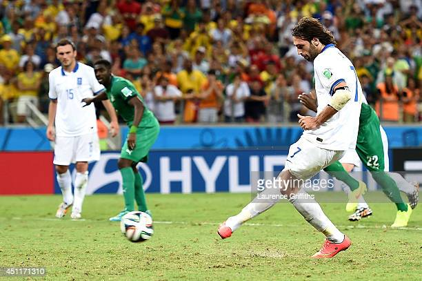 Giorgos Samaras of Greece scores his team's second goal on a penalty kick during the 2014 FIFA World Cup Brazil Group C match between Greece and the...
