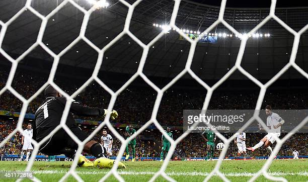 Giorgos Samaras of Greece scores his team's second goal on a penalty kick past Boubacar Barry of the Ivory Coast during the 2014 FIFA World Cup...
