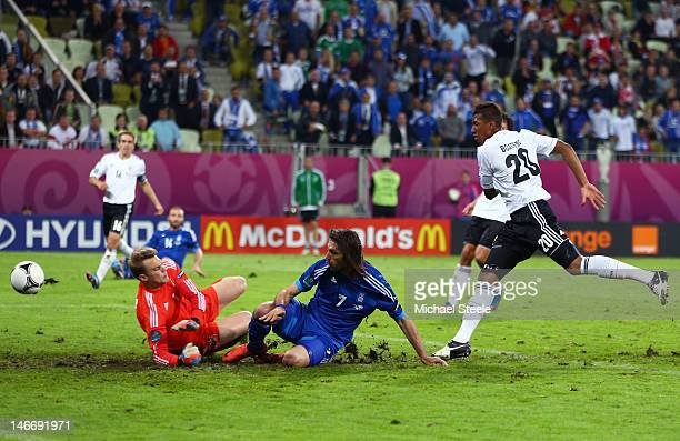 Giorgos Samaras of Greece scores their first goal past Manuel Neuer of Germany during the UEFA EURO 2012 quarter final match between Germany and...