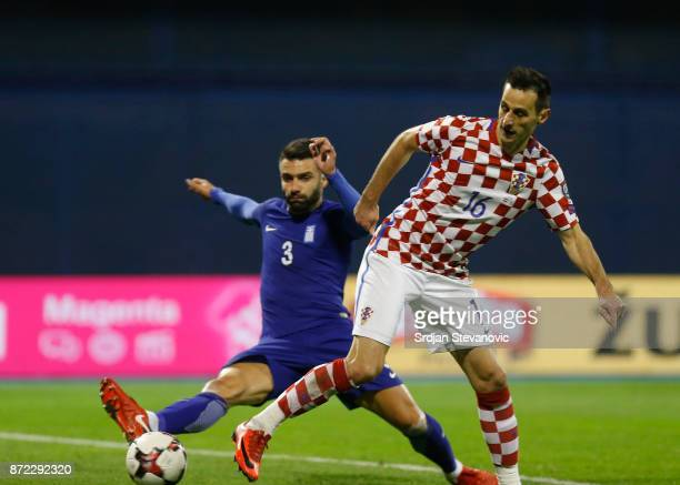 Giorgos Tzavellas of Greece is challenged by Nikola Kalinic of Croatia during the FIFA 2018 World Cup Qualifier PlayOff First Leg between Croatia and...