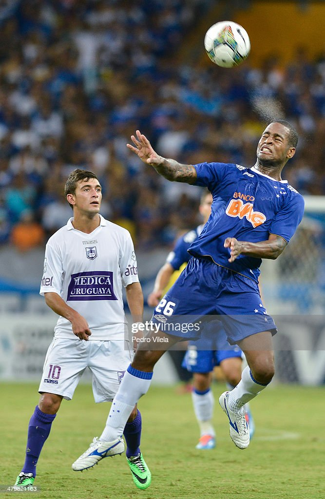 Giorjian of Defensor and Dede of Cruzeiro during the match between Cruzeiro v Defensor for the Copa Briedgestone Libertadores 2014 at Mineirao stadium on march 20, 2014 in Belo Horizonte, Brazil.