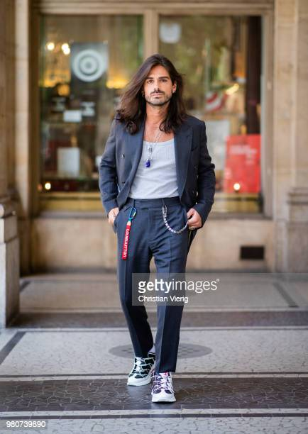 80b583f8199e2 Giotto Calendoli wearing black suit Louis Vuitton sneakers is seen outside Louis  Vuitton on day three