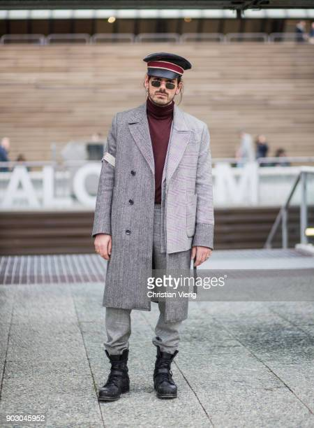 Giotto Calendoli wearing military hat wool coat leather boots turtleneck is seen during the 93 Pitti Immagine Uomo at Fortezza Da Basso on January 9...