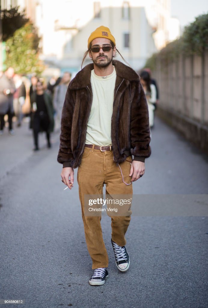 Giotto Calendoli wearing yellow beanie, brown jacket, light brown pants is seen outside Diesel during Milan Men's Fashion Week Fall/Winter 2018/19 on January 13, 2018 in Milan, Italy.