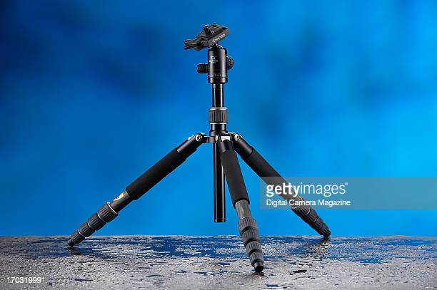 A Giottos Vitruvian carbon fibre tripod kit photographed on wet slate with a blue background on November 8 2012