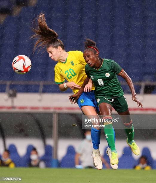 Giovana of Team Brazil competes for a header with Margaret Belemu of Team Zambia during the Women's Group F match between Brazil and Zambia on day...