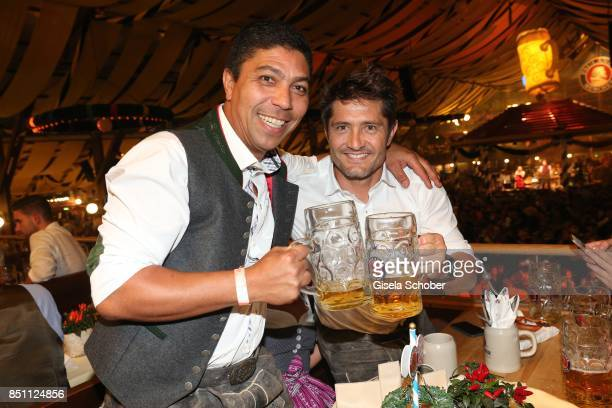 Giovane Elber and Bixente Lizarazu former FC Bayern soccer player during the Oktoberfest at Winzerer Faehndl tent at Theresienwiese on September 21...